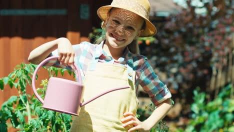 Girl-8-Age-Holds-Watering-Can-And-Smiling-At-Camera