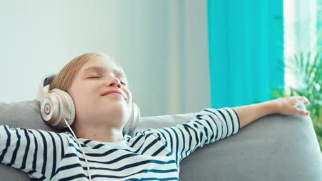 Girl-8-Age-Relaxing-With-Music-In-Headphones