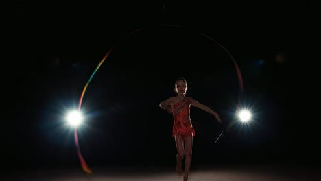 Girl-8-Years-Old-Dancing-With-Gymnast-Ribbon-At-Night