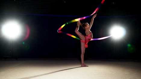 Girl-8-Years-Old-Dancing-With-Rhythmic-Gymnast-Ribbon-At-Night-Slow-Motion