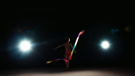 Girl-8-Years-Old-Dancing-With-Rhythmic-Gymnast-Ribbon-At-Night