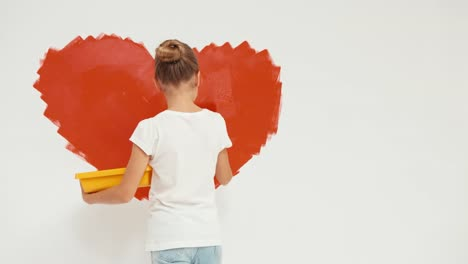 Girl-9-Years-Paints-Heart-On-The-Wall