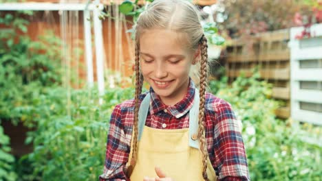 Girl-Child-8-Age-Holds-In-Hand-Seeds-Of-Vegetables-Smiling-At-Camera-And-Show