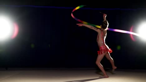 Young-girl-dancing-with-rhythmic-gymnast-ribbon-in-slow-motion-1