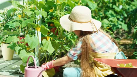 Girl-Child-Working-In-The-Kitchen-Garden-And-Smiling-At-Camera