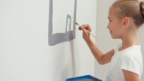 Niña-Dibujando-En-La-Pared-Una-Casa