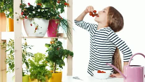 Girl-Eating-Cherry-Tomatoes-On-White-Background