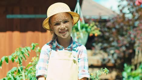 Girl-Holds-Watering-Can-In-The-Kitchen-Garden