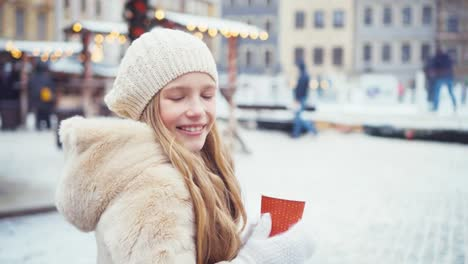 Girl-Looking-Of-Winter-Skating-Rink-And-Sitting-On-Bench-Child-Holds-Cup-Of-Tea