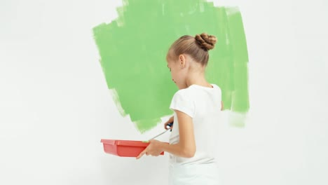 Girl-Painting-Wall-To-Green-Color