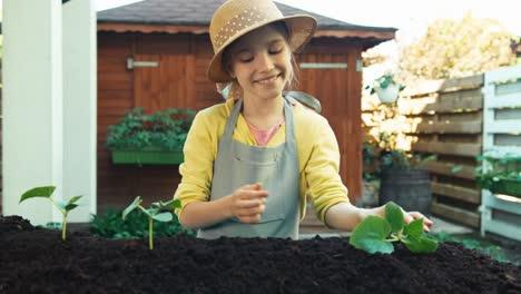 Girl-Planting-Vegetables-To-Soil