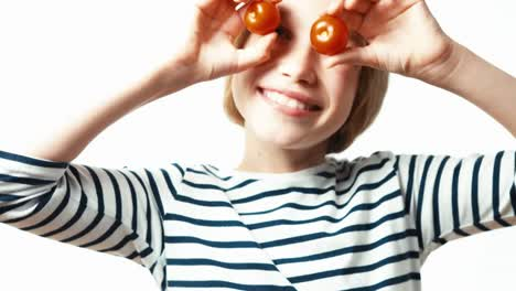 Girl-Playing-With-Cherry-Tomatoes
