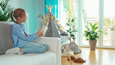 Girl-Reading-Book-In-Living-Room