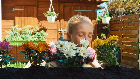 Girl-Sniffing-Flowers-And-Smiling-Dolly-Shot