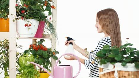 Mädchen-Streut-Gemüse-In-Töpfen-Auf-Weißem-Hintergrund