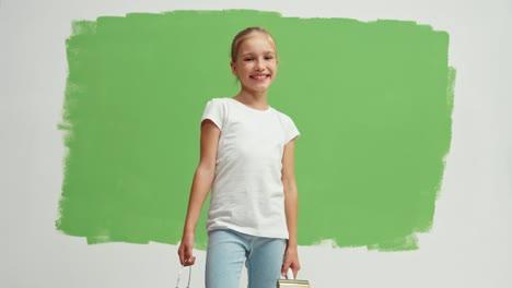 Girl-Standing-Green-Screen-Holds-Paint-Brush