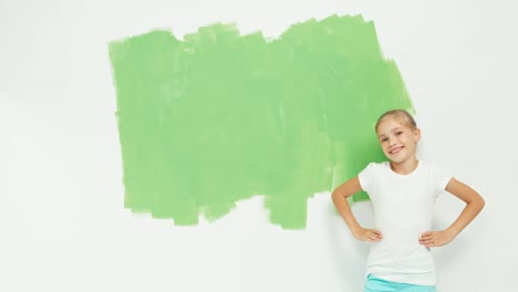 Girl-Standing-Near-Green-Screen-And-Looking-At-Camera
