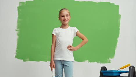 Girl-Turns-Around-At-Camera-Child-Standing-On-The-Green-Screen