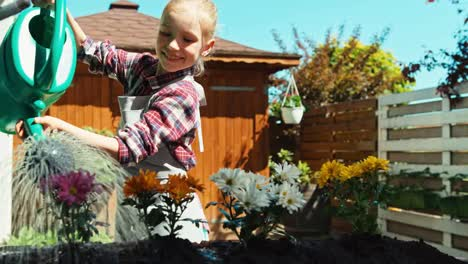 Girl-Watering-Flowers-In-The-Garden-And-Laughing-At-Camera-Dolly-Shot