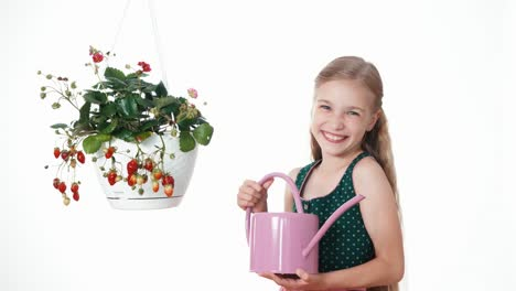 Girl-Watering-Strawberry-On-White-Background