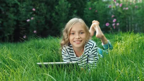 Girl-With-Tablet-PC-In-Grass