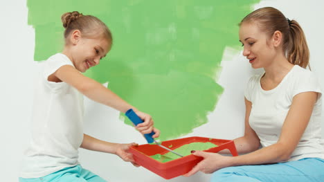 Happy-Family-Painting-Wall-To-Green-Color