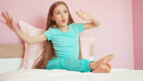 Laughing-Child-Girl-9-Years-Sitting-On-The-Bed-And-Dancing