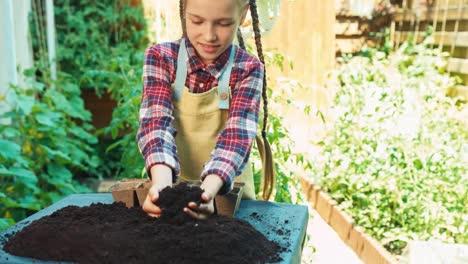 Little-Farmer-Girl-Prepares-Soil-For-Seedlings