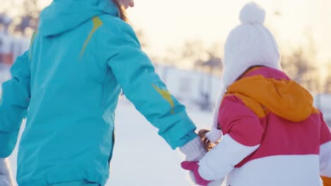 Mother-And-Daughter-Have-Fun-On-Winter-Hill-Running-To-The-Hill