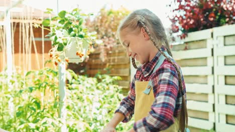 Mother-And-Daughter-Planting-Seedling