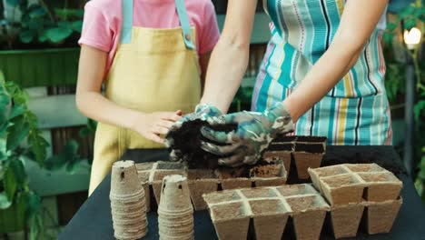 Mother-And-Daughter-Will-Be-Sowing-Seeds-To-Biodegradable-Pots