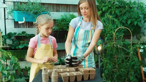 Mother-And-Daughter-Will-Be-Sowing-Seeds