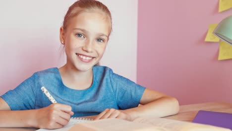 Portrait-Cheerful-Blond-Student-Girl-9-Aged-Doing-Homework-At-The-Table-Dolly