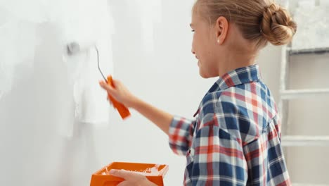 Portrait-Cheerful-Girl-9-Years-Old-Repairing-Her-House-Using-Paint-Roller