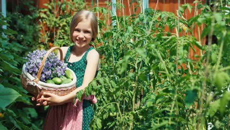 Portrait-Cheerful-Girl-With-Basket-Of-Vegetables-And-Flowers-In-Her-Own-Kitchen