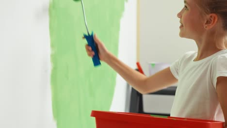 Portrait-Girl-Painting-Wall-To-Green-Color