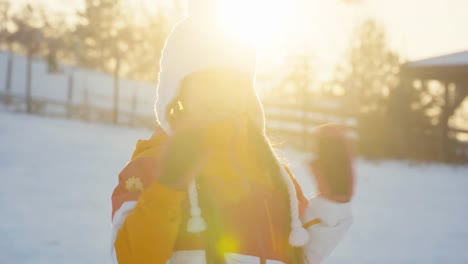 Portrait-Happy-Child-Holds-Snow-Disk-And-Smiling-At-Camera-In-Winter-Sunny-Day
