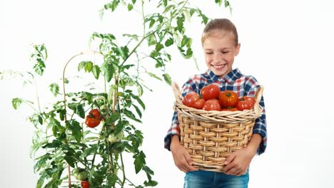 Portrait-Laughing-Girl-8-Aged-Holding-Basket-With-Tomatoes-Child-Standing-On