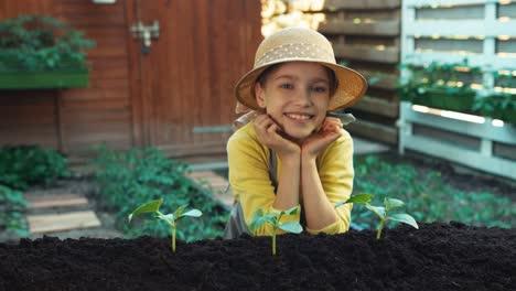 Portrait-Little-Farmer-Wich-Planted-Vegetables-To-Soil