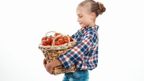 Portrait-Smiling-Girl-8-Aged-Holding-Basket-With-Tomatoes-Isolated-On-White