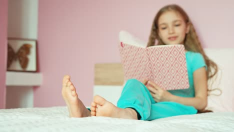 Schoolgirl-Reading-On-Bed-And-Laughing