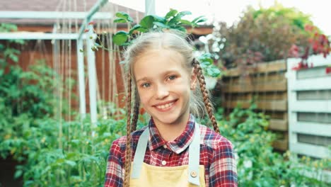 Seeds-In-Palms-Of-Child-Girl-Smiling-At-Camera