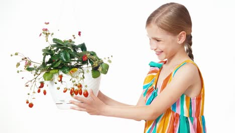 Smiling-Child-Looking-At-The-Butterfly-That-Sits-On-A-Hanging-Pot