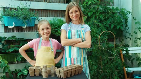 Two-Young-Farmers-Mother-And-Daughter-Planning-Planting-Seeds-In-The-Patio