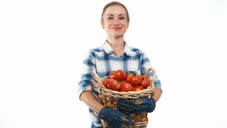Woman-Turned-To-Look-At-Camera-With-Basket-Of-Tomato-Isolated-On-White