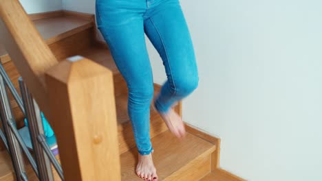 Woman-Using-Cell-Phone-Sitting-On-The-Stairs-At-Home