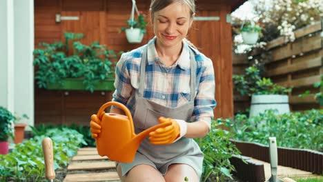 Woman-Watering-Seedling-Of-Vegetables-In-Her-Patio