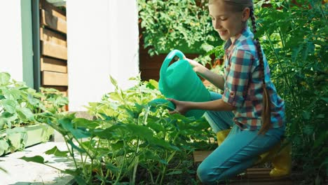 Young-Farmer-Child-Is-Watering-Cucumbers