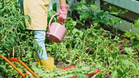 Young-Farmer-Girl-Working-In-The-Garden-Girl-Using-Watering-Can-In-Her-Garden