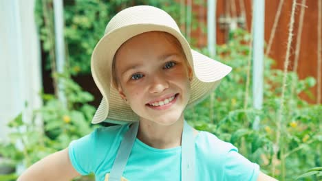 Young-Farmer-Is-Approach-At-Camera-In-Kitchen-Garden